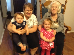 Me, holding Kayla, and Nano (Mamie), holding Claire.  Now running from age 3-98.